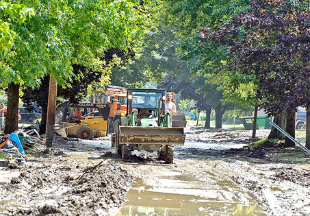 [NYDH photo of mud cleanup in Gowanda, NY after the August 9-10, 2009 flood]