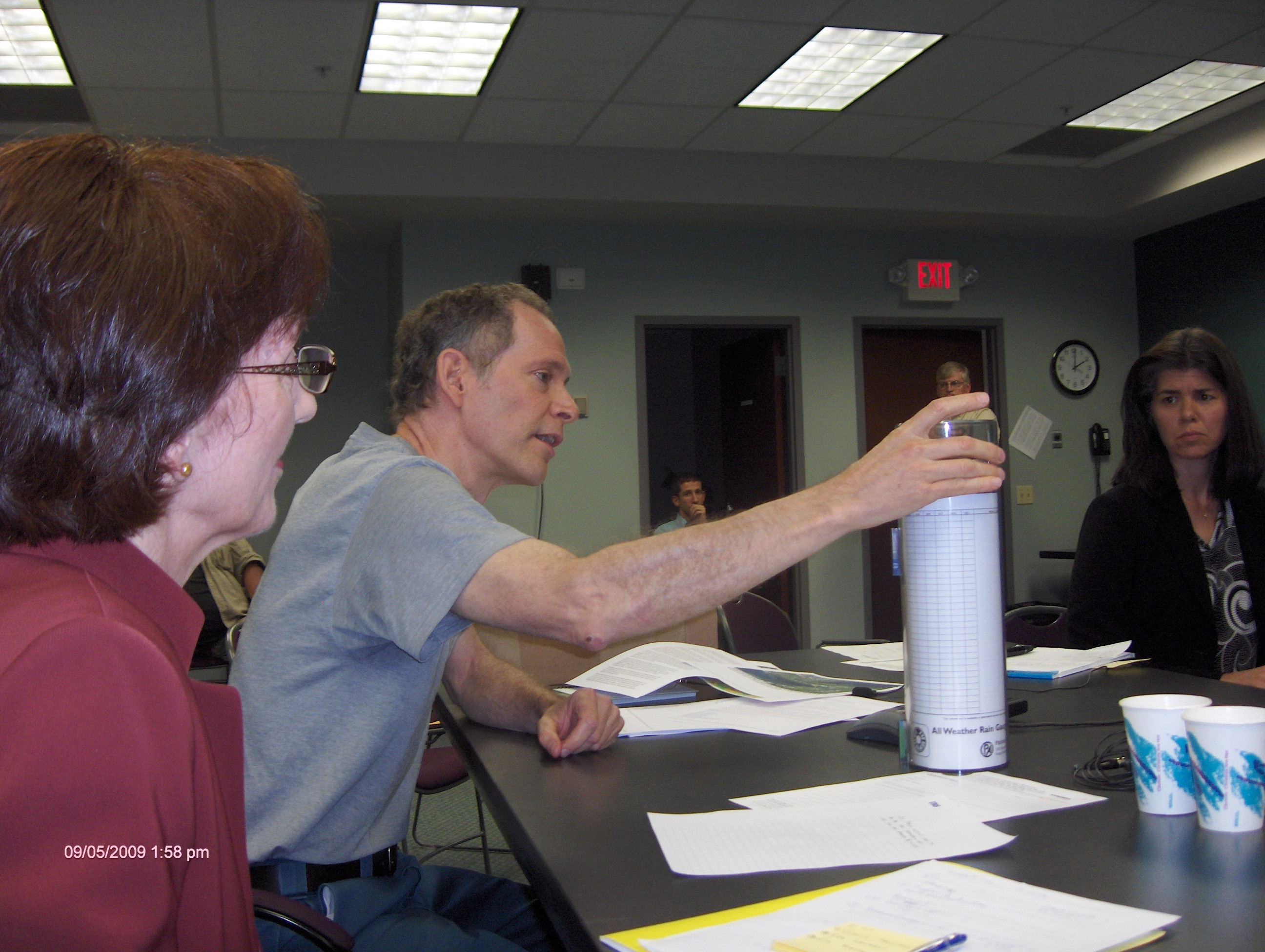 Jim Rauch describes CoCoRaHS rain gauge similar to gauge used by Perrysburg spotter to gather 8/9 intensity measurement